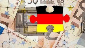 Merkel euroyu savunmayı taahhüt etti